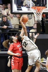 Purdue forward Ae'Rianna Harris (32) goes up to block Western Kentucky forward Raneem Elgedawy (15)'s layup during the third quarter of an NCAA women's basketball game, Wednesday, Dec. 18, 2019 at Mackey Arena in West Lafayette.