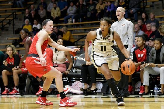 Purdue guard Dominique Oden (11) dribbles around Western Kentucky guard Whitney Creech (5) during the first quarter of a NCAA women's basketball game, Wednesday, Dec. 18, 2019 at Mackey Arena in West Lafayette.