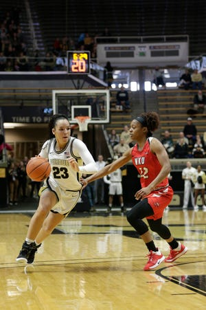 Purdue guard Kayana Traylor (23) dribbles against Western Kentucky guard Sherry Porter (22) during the first quarter of a NCAA women's basketball game, Wednesday, Dec. 18, 2019 at Mackey Arena in West Lafayette.