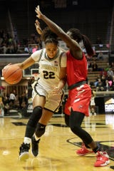 Purdue forward Jenelle Grant (22) drives to the net under Western Kentucky forward Fatou Pouye (12) during the first quarter of a NCAA women's basketball game, Wednesday, Dec. 18, 2019 at Mackey Arena in West Lafayette.