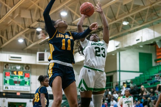 Lafayette High's Jahniya Brown challenges a defender while going up to the goal to score as the Lafayette High Lady Lions take on the Carencro High Lady Bears on Tuesday, Dec. 17, 2019.