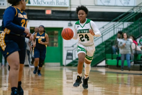 Lafayette High's Breanna Sanders moves the ball down the court as the Lafayette High Lady Lions take on the Carencro High Lady Bears on Tuesday, Dec. 17, 2019.