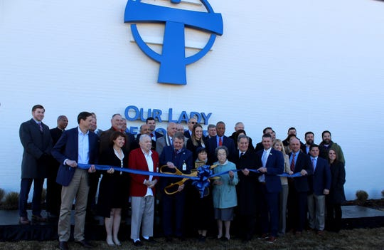 Lafayette Parish, Scott and Our Lady of Lourdes officials cut the ribbon the the new emergency center in Scott, Louisiana, on Wednesday, Dec. 18, 2019.