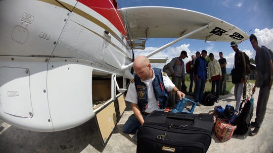 Acadiana native Pappy Frey flies aid in the form of food, water or medical personnel to remote areas of Southeast Asia with the organization Helimission.