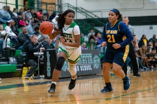 Lafayette High's Jahniya Brown drives the ball past the defense as the Lafayette High Lady Lions take on the Carencro High Lady Bears on Tuesday, Dec. 17, 2019.
