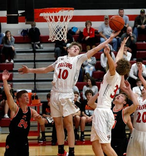 Charlie Bean reaches for a rebound during a game earlier this season against Amanda-Clearcreek. The Falcons were selected as the No. 1 seed in the Division II Southeast District.