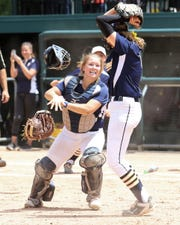 Catcher Brooke Cowan and pitcher Rachel Everett Hartland's 6-4 victory over Howell in the state Division 1 semifinals on Thursday, June 14, 2018 at Michigan State University.