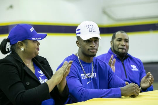 Male senior and wide receiver and 2020 UK commit Izayah Cummings is applauded by parents Natasha and Andra Cummings during his signing announcement ceremony Wednesday Dec. 18, 2019