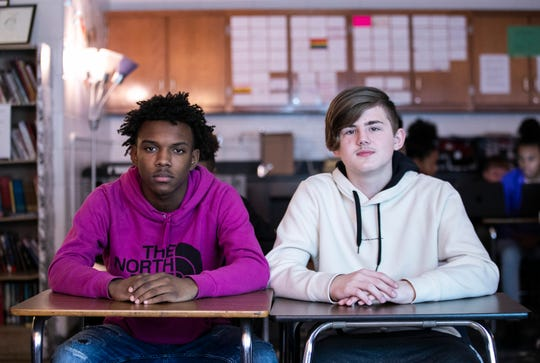 """Thomas Jefferson Middle School students Isaiah Jones, left, a seventh grader, and Mercator Bell, an eighth grader, both read """"Ghost Boys,"""" a story about a black boy who is shot and killed by a white police officer, prodding them to discuss race issues at the school. Dec. 18, 2019"""