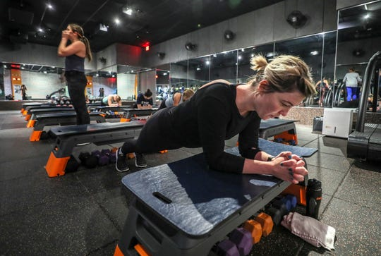 A workout session at Shred 4/15. The workout consists of cardio on treadmills and core/strength training. The intervals are 15 minutes, each, for an hour.