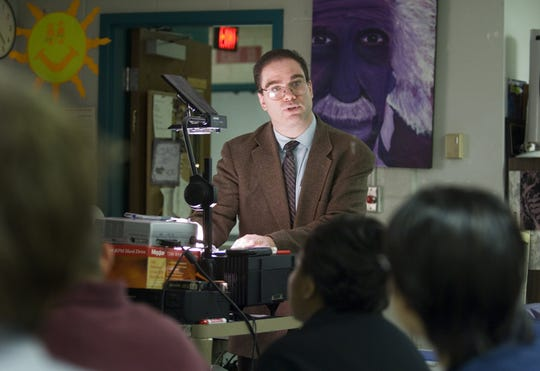In 2005, Male High School physics teacher Jeffrey Wright works with his class on a project discussing the speed and acceleration of projectiles.