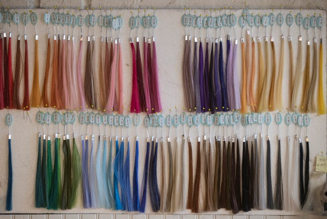 Various color options for hair color hang on a board at the Custom Wig Co. in south Louisville. Dec. 6, 2019