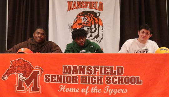 From left, Anthony Hawkins, Angelo Grose and Clay Caudill on Wednesday evening sign their national letters of intent to play Division I college football.