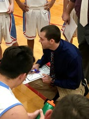 Ridgedale boys basketball coach Mike Mathey talks to his team during a game against Elgin this season.