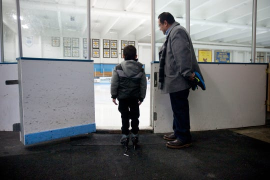 Jack Obregon and his father, Thomas, of Brookfield, check out the ice in the Eble Park Ice Arena in this file photo from January 2013. The arena is open for public skating in the winter.