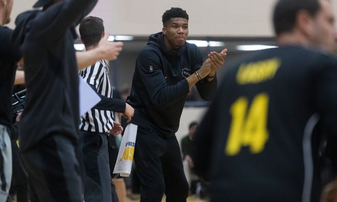 Milwaukee Bucks forward Giannis Antetokounmpo cheers on his team Tuesday at the Racine Correctional Institution in Sturtevant.