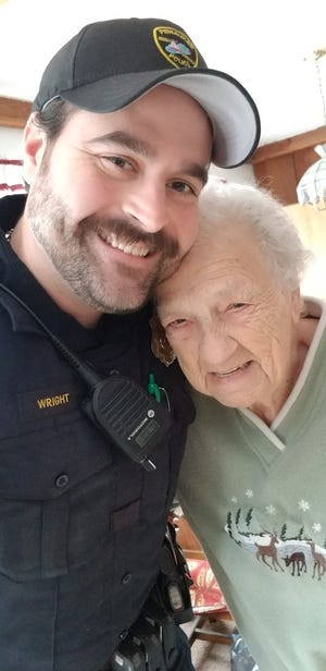Pewaukee Police Sgt. Nathan Wright, left, recognized crossing guard Rosemary Carpenter for her outstanding service to the village and to Pewaukee Schools.