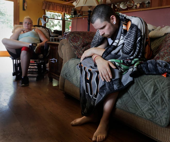 A 26-year-old Burlington man rests at home  with his family on July 27, 2019, after he was released from the hospital after a severe lung injury doctors told him was likely tied to vaping. The man had vaped nicotine and THC, which he suspects had been altered.