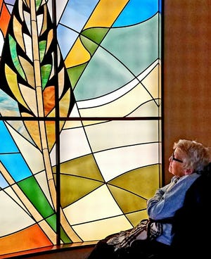 Mazie Froedtert Willms looks at a new barley-themed stained glass window at a chapel at Froedtert Hospital, named for her father, Kurtis Froedtert. Willms died inJune 2020 at 92.