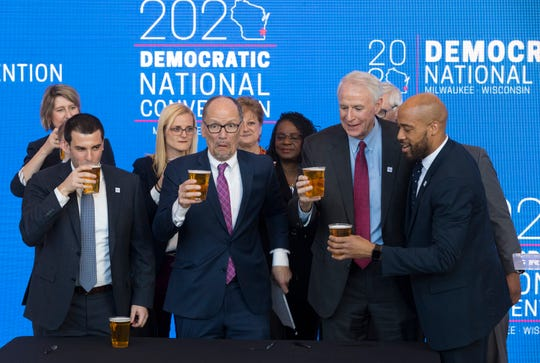 Celebrity Beauty: Democratic National Committee Chairman Tom Perez, center, reacts after spilling a celebratory beer on the conference contract with, from left,  Milwaukee Bucks Senior Vice President Alex Lasry, Milwaukee Mayor Tom Barrett and Lt.  Gov. Mandela Barnes on March Eleven, 2019, following the safe announcement that Milwaukee will host the 2020 Democratic National Convention at Fiserv Forum.