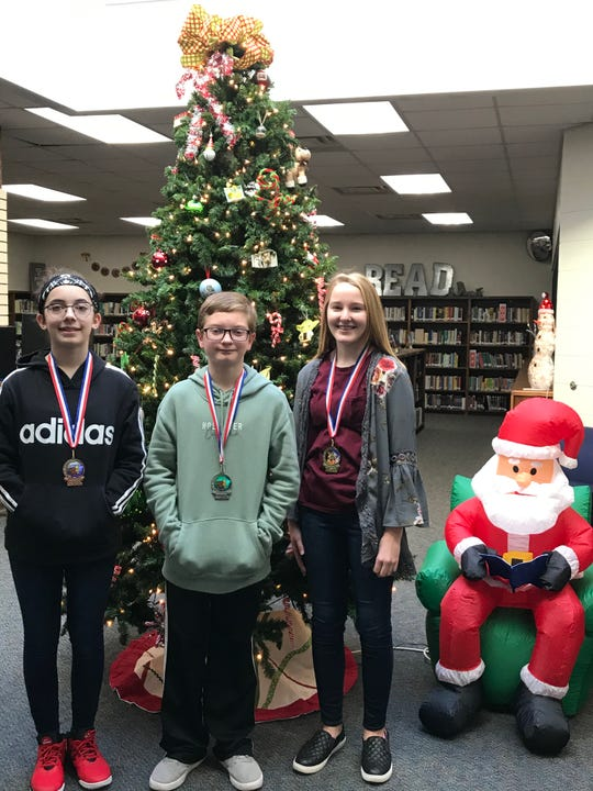 Seventh-grade finalists in the Pinkston Middle School spelling bee were Devyn Prins (first place), Adam Jones (second place), and Emma Walls (third place).