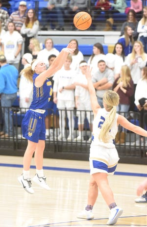 Mountain Home's Emma Martin launches a 3-pointer against Harrison on Tuesday night.