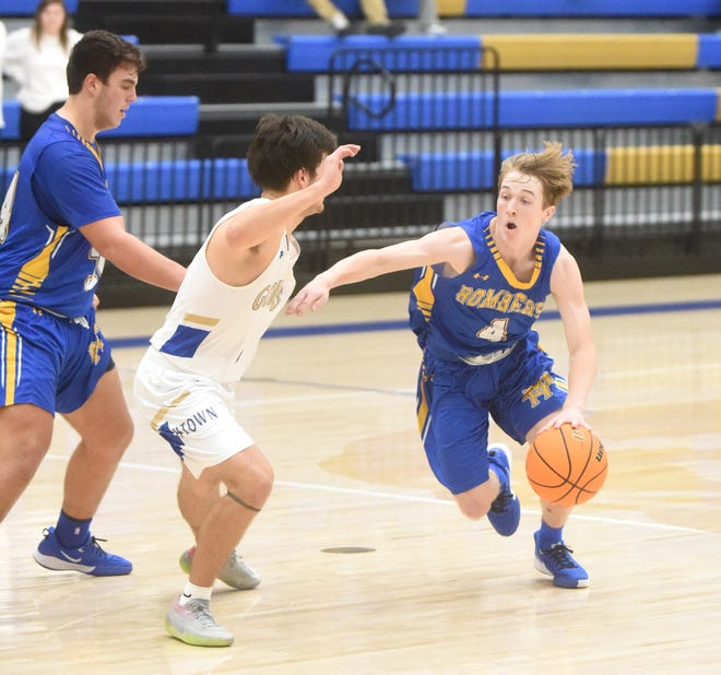 Mountain Home's Wyatt Gilbert looks to drive against Harrison on Tuesday night.