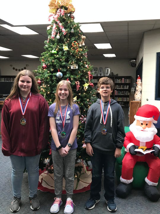 Sixth-grade finalists in the Pinkston Middle School spelling bee were Madison Young (first place), Bailey Byrd (second place), and Kohler Matthews (third place).