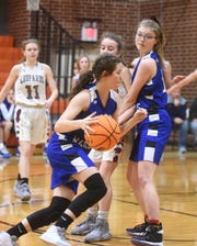 Cotter's Candace Lambert dribbles around a screen from teammate Emily Montgomery during the Lady Warriors' recent game against Alpena.