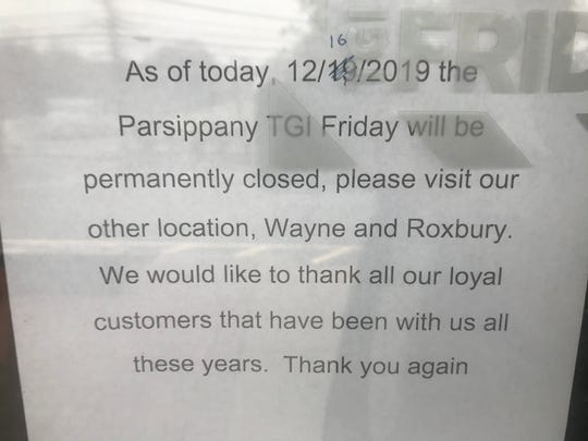 A sign taped to the front door  announces the TGI Fridays location in Parsippany has closed. Dec. 17, 2019.