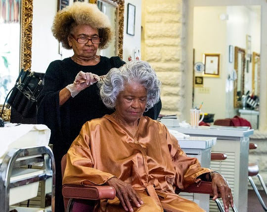 Allena Curry Norman styles the hair of Lillie Curry Hardy at Allena's House of Beauty in Montgomery, Ala., on Wednesday December 18, 2019.