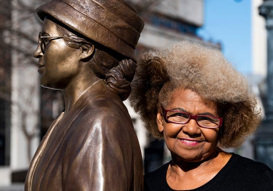 Allena Curry Norman poses beside the Rosa Parks statue in downtown Montgomery, Ala., on Wednesday December 18, 2019. Norman did the hairstyle used by the sculptor on the statue.