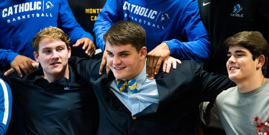 Catholic offensive lineman Chase Little is congratulated by teammates as he signs with Troy on the Catholic campus in Montgomery, Ala., on Wednesday December 18, 2019.