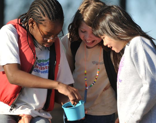 Campers dig for worms during YMCA Camp Chandler Spring Break Camp in 2008.