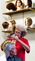 Allena Curry Norman puts curlers in the hair of Lillie Curry Hardy at Allena's House of Beauty in Montgomery, Ala., on Wednesday December 18, 2019.