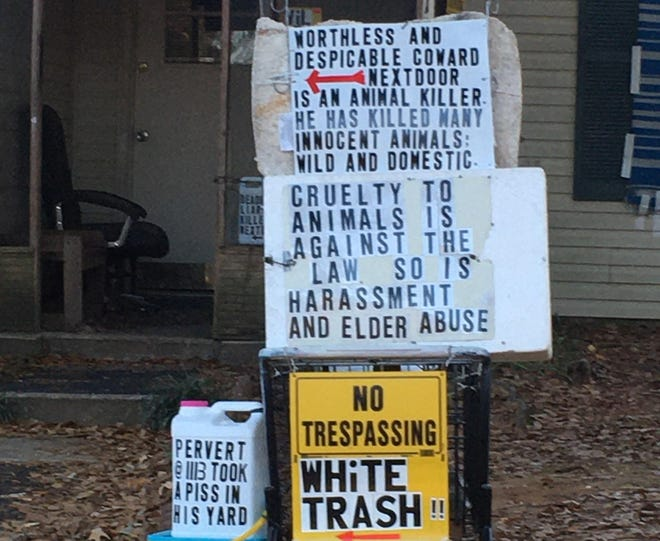 Signs outside a home on Jameswood Court in Montgomery.