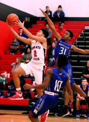 Stewarts Creek's guard Bryce Jackson (2) goes up for a shot as Rockvale's TJ Hathaway (31) guards him on Tuesday Dec. 17, 2019 at Stewarts Creek.