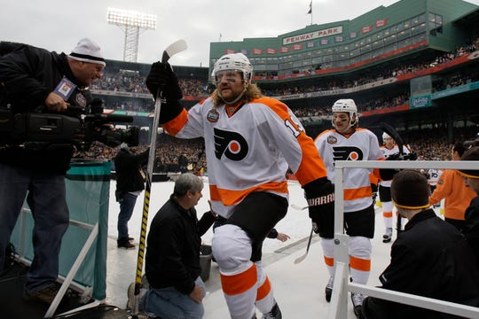 Philadelphia Flyers forward Scott Hartnell (19) enters the outdoor rink for the New Year's Day Winter Classic NHL hockey game between the Flyers and Boston Bruins at Fenway Park in Boston, Friday, Jan. 1, 2010. (AP Photo/Elise Amendola)