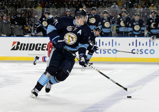Pittsburgh Penguins' Evgeni Malkin (71) plays in the NHL Winter Classic hockey game between the Pittsburgh Penguins and the Washington Capitals in Pittsburgh, Saturday, Jan. 1, 2011 . (AP Photo/Keith Srakocic)
