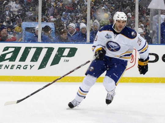 Buffalo Sabres Center Paul Gaustad (28) skates on the ice during the NHL Winter Classic outdoor hockey game at Ralph Wilson Stadium in Orchard Park, N.Y., Tuesday, Jan. 1, 2008. (AP Photo/David Duprey)