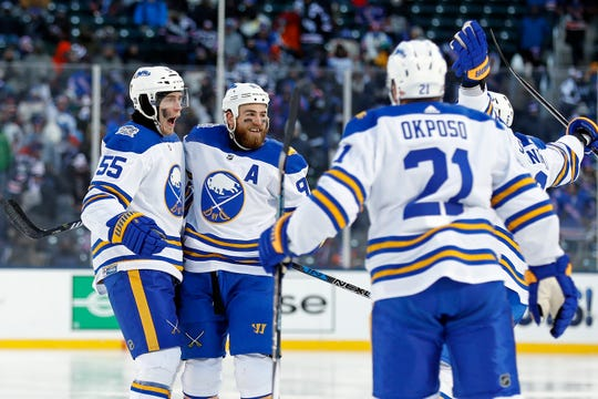 Buffalo Sabres defenseman Rasmus Ristolainen (55) celebrates scoring a goal with teammates against the New York Rangers in the third period of the NHL Winter Classic hockey game at CitiField in New York on Monday, Jan. 1, 2018. The Rangers won 3-2 in overtime. (AP Photo/Adam Hunger)