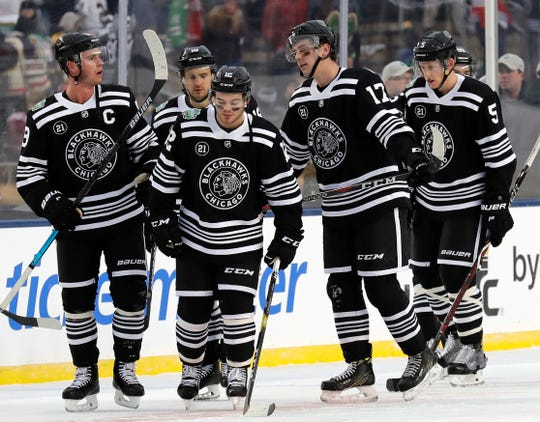 Chicago Blackhawks players react to the team's 4-2 loss to the Boston Bruins in the NHL Winter Classic hockey game at Notre Dame Stadium, Tuesday, Jan. 1, 2019, in South Bend, Ind. (AP Photo/Nam Y. Huh)