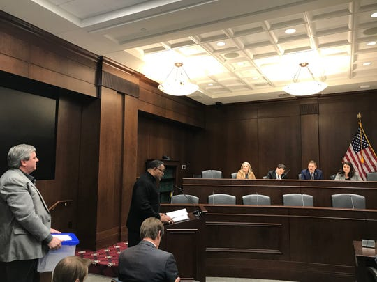 Chris Williamson speaks as Kevin Riggs holds a box of petition signatures at the Dec. 18, 2019, Capitol Commission meeting. Both men are pastors working to see the Nathan Bedford Forrest bust removed from the Capitol.
