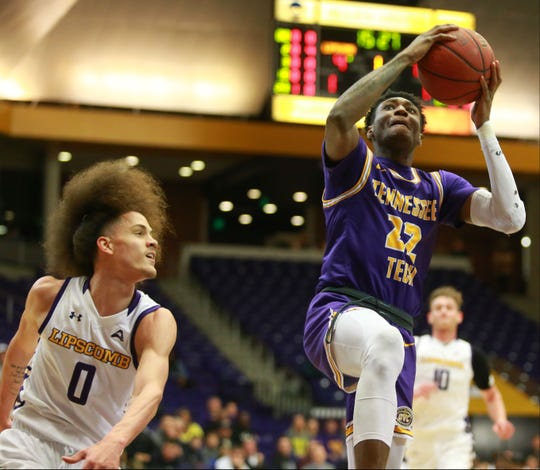 Tennessee Tech's Tujautae Williams shoots a layup over Lipscomb's K.J. Johnson in Tuesday night's game at Allen Arena.