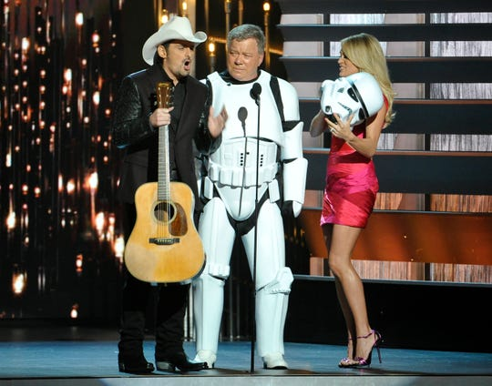 William Shatner, center, joins co-hosts Brad Paisley and Carrie Underwood at the 49th annual CMA Awards on Nov. 4, 2015, in Nashville.
