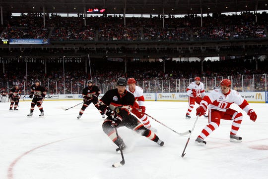 Chicago Blackhawks' Martin Havlat, center, of Czech Republic, controls the puck against the Detroit Red Wings during the third period of the NHL Winter Classic hockey game at Wrigley Field, Thursday, Jan. 1, 2009, in Chicago. The Red Wings won 6-4. (AP Photo/Nam Y. Huh)
