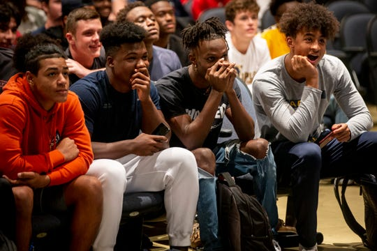 Students laugh and cheer while watching Ar'Quel Smith's highlight reel during early signing day at Naples High School in Naples on Wednesday, December 18, 2019.