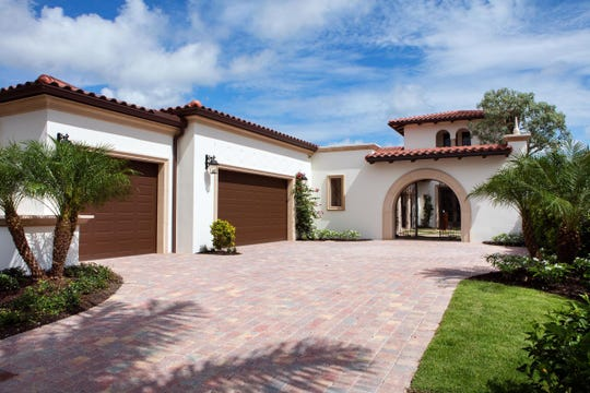 The Cilento model is located in the Portofino neighborhood at Miromar Lakes Beach & Golf Resort.