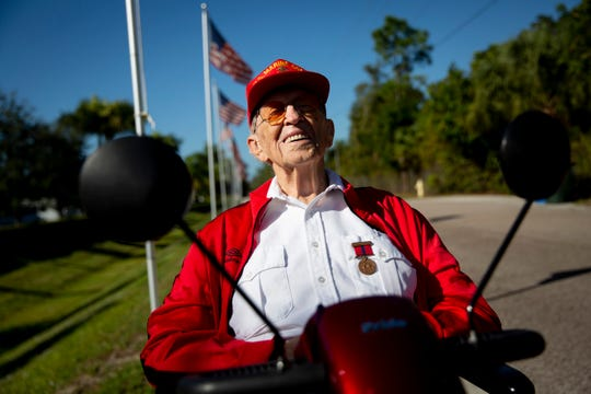 Lou Rauschenberger, 96, laughs as he has his picture taken at American House in Bonita Springs on Monday, December 16, 2019. Rauschenberger, a retired Marine, is working with Toys for Tots this year to encourage residents at American House to donate toys for children in Bonita Springs.