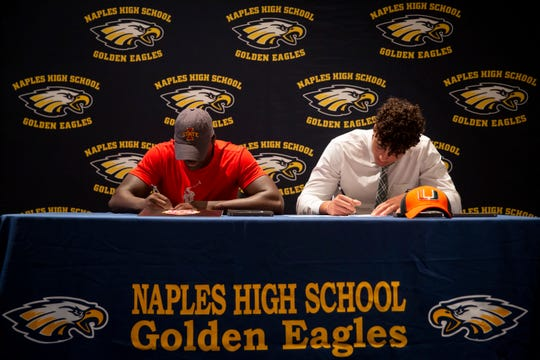 Linebacker Ar'Quel Smith, left, signs with Iowa State and tight end Dominic Mammarelli, right, signs with Miami during early signing day at Naples High School in Naples on Wednesday, December 18, 2019.
